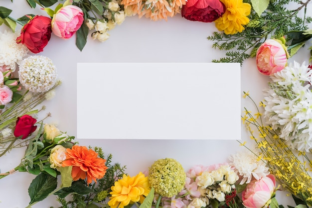 Composition of paper between flowers and leaves