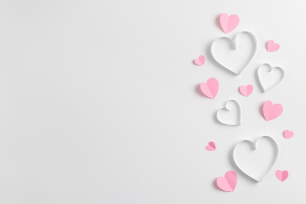 Composition of pink hearts made of paper