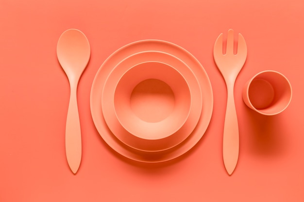 Composition of pink plastic served dish