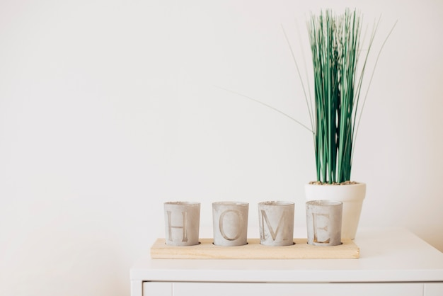 Composition of plant pots with home note