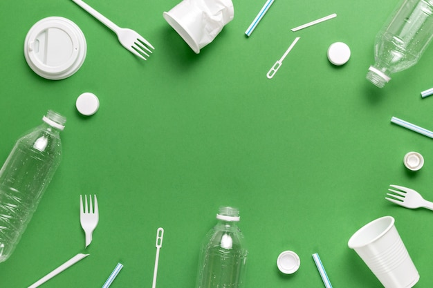 Composition of plastic waste pollution. sorting and recycling. disposable packaging. ecological concept. flat lay, top view, copy space.