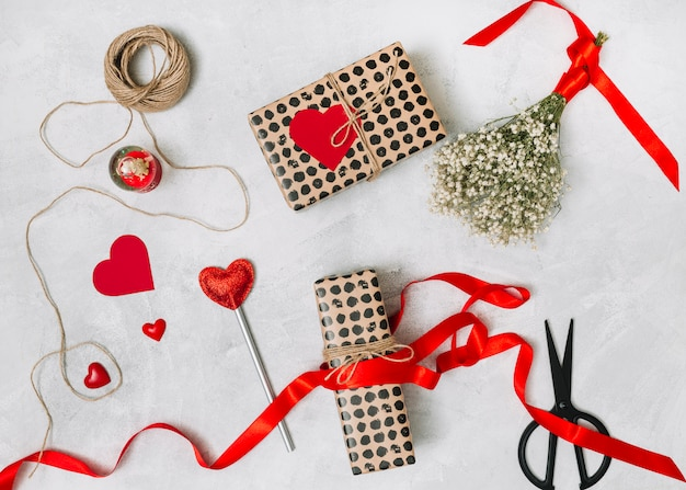 Composition of present boxes, ornament hearts, plant andtwist