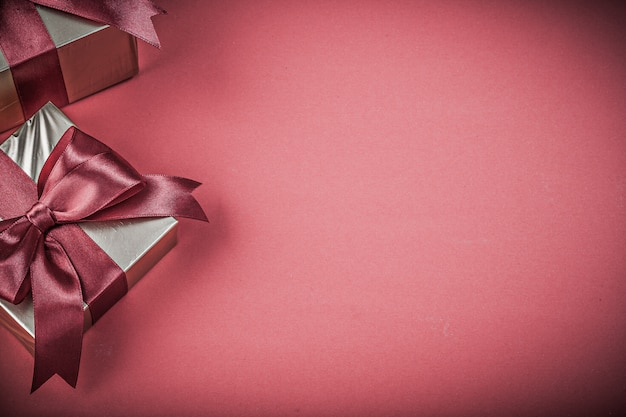 Composition of present boxes on red background holidays concept