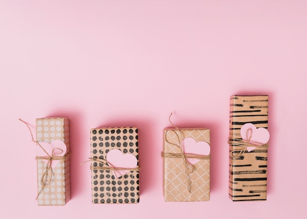 Composition of present boxes with decorative paper hearts