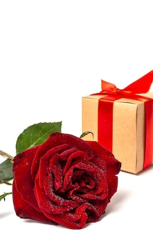 Composition of red roses and gift boxes