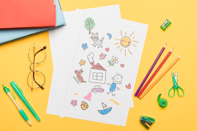 Composition of school stationery with drawing