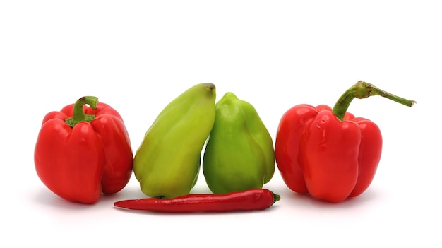 Composition of several types of sweet pepper of different shapes, colors and sizes on a light background. natural product. natural color. close-up.