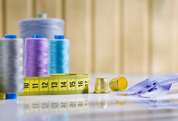 Composition of sewing items on white table