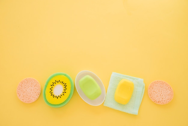 Composition of skin care products on yellow background