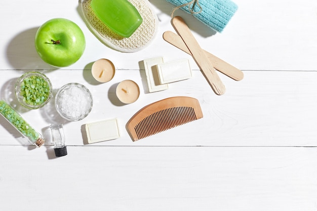 Composition of spa treatment on white wooden table with space for text top view