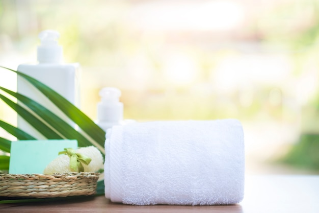 Composition of spa treatment on wooden table.