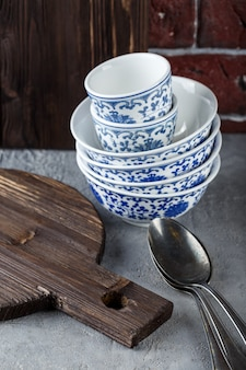 Composition of spoons, bowls and cutting board