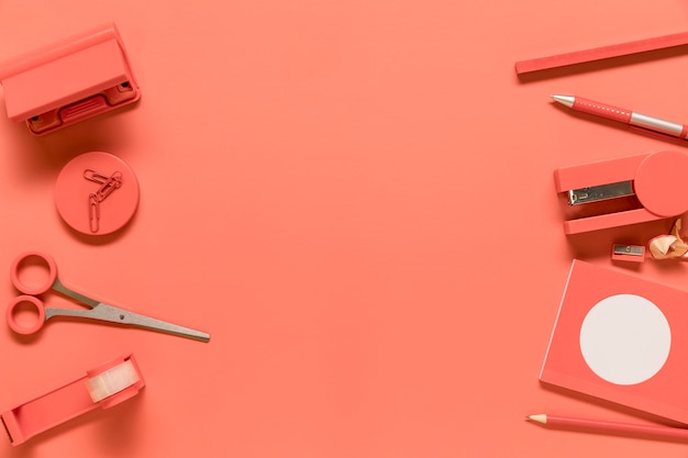 Composition of stationery supplies in pink color