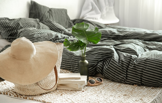 Composition of summer accessories on the background of the bedroom.