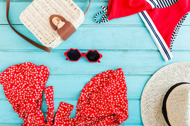Composition of summer accessories on blue background