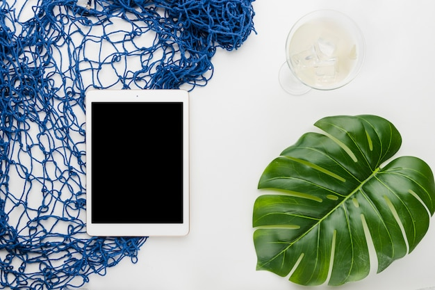 Composition of tablet beverage monstera leaf and fishnet