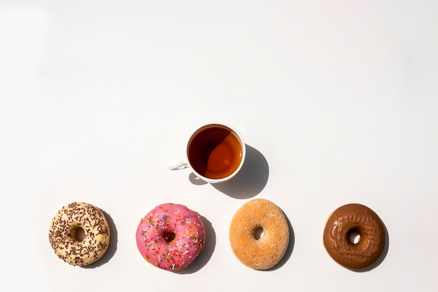 Composition of tea with donuts