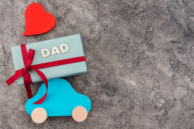Composition of toy car and gift box for father`s day