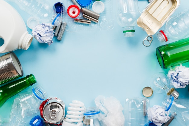 Composition of trash for recycling on blue background
