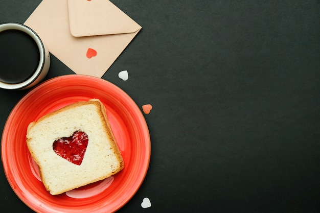 Composition for valentines day card with coffee, enveloope and sandwich heart shaped