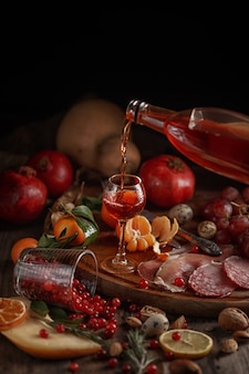 Composition of various foodstuffs on a wooden table. top view.