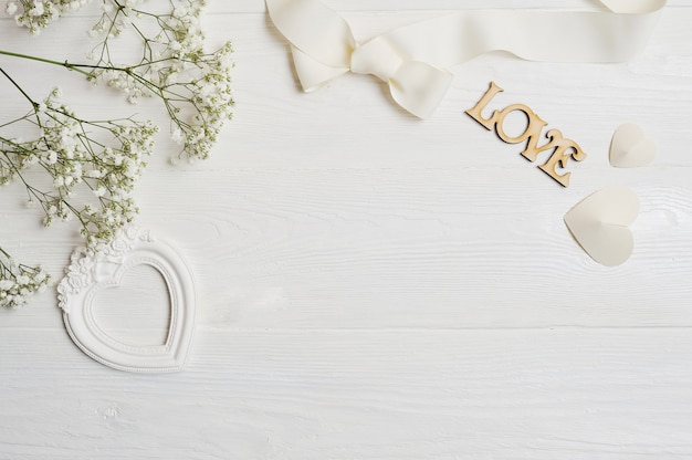 Composition of white flowers rustic style, hearts love and a gift
