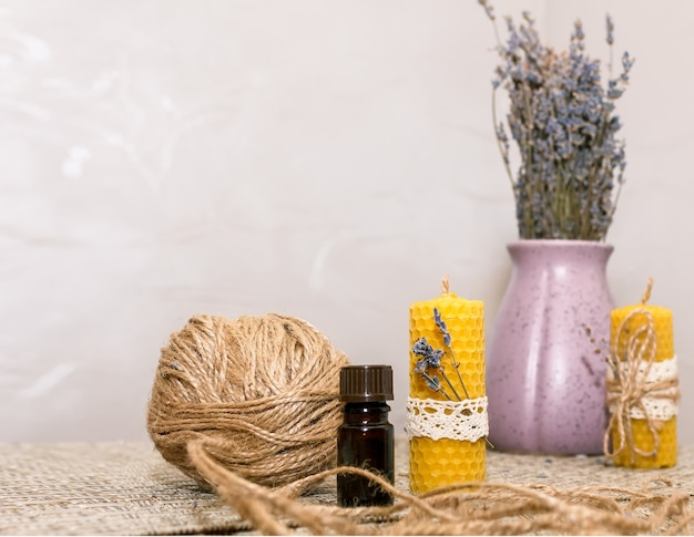 Composition with accessories for making wax candles with your own hands and a vase with lavender flowers