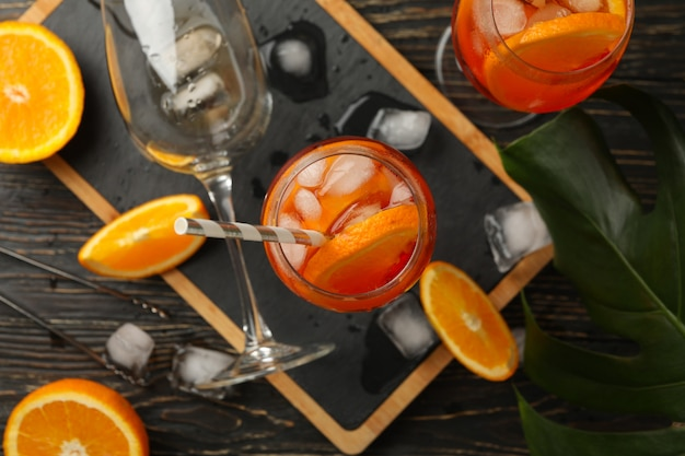 Composition with aperol spritz cocktail on wooden.