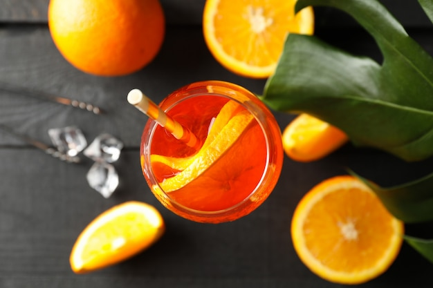 Composition with aperol spritz cocktail on wooden