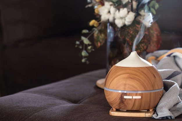 Composition with aroma oil diffuser lamp and decor details. aromatherapy and health care concept.