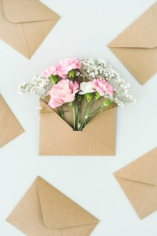 Composition with beautiful flowers and envelopes