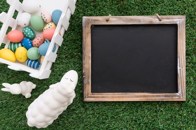 Composition with blank slate and easter items