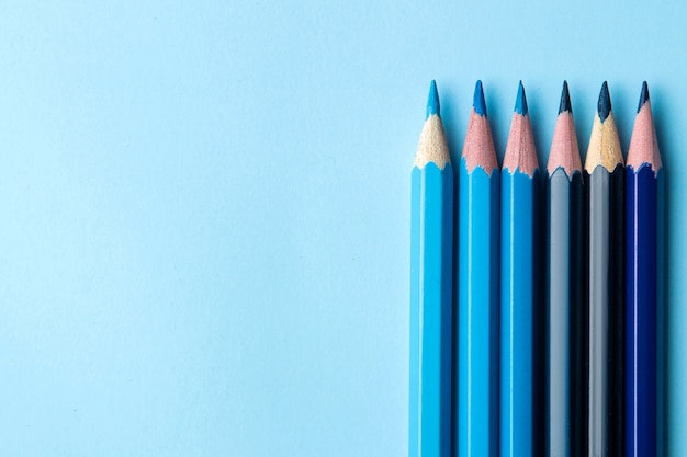 Composition with blue pencils on a bright blue background. close-up. place for text. top view