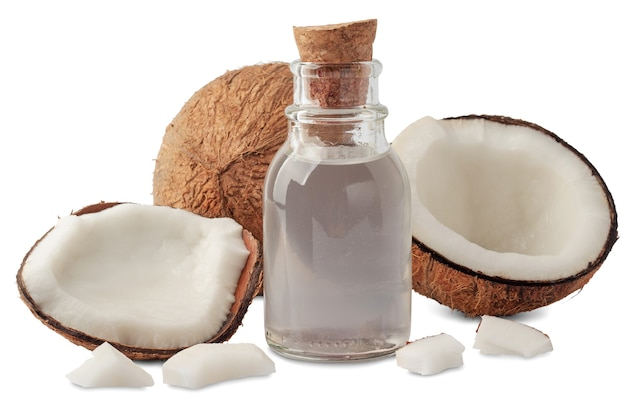 Composition with bottle of coconut oil and yummy nuts, isolated on white
