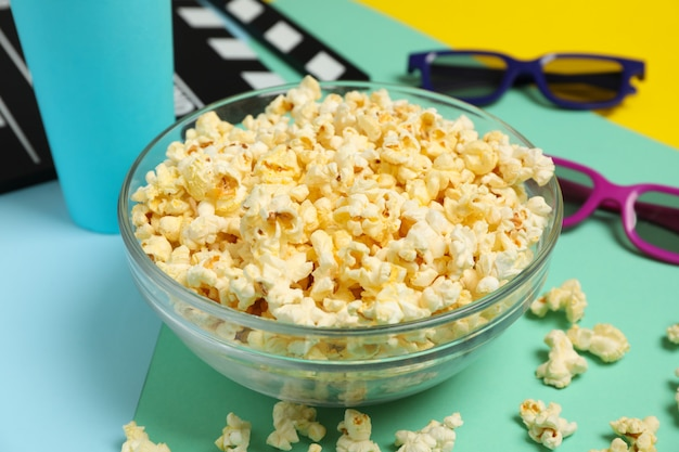 Composition with bowl of popcorn on multicolor