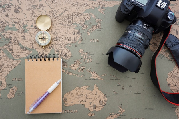 Composition with camera, notebook and compass