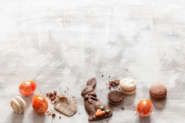 Composition with chocolate easter hare and eggs.