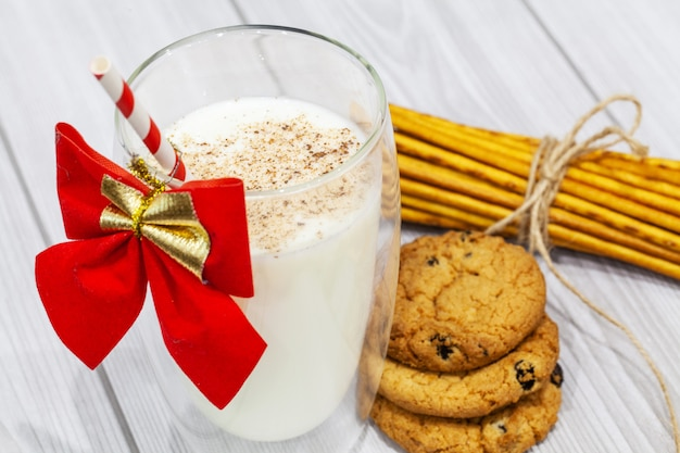 Composition with christmas cookies and milk on white background