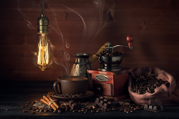 Composition with a coffee grinder and smoking coffee in the old style