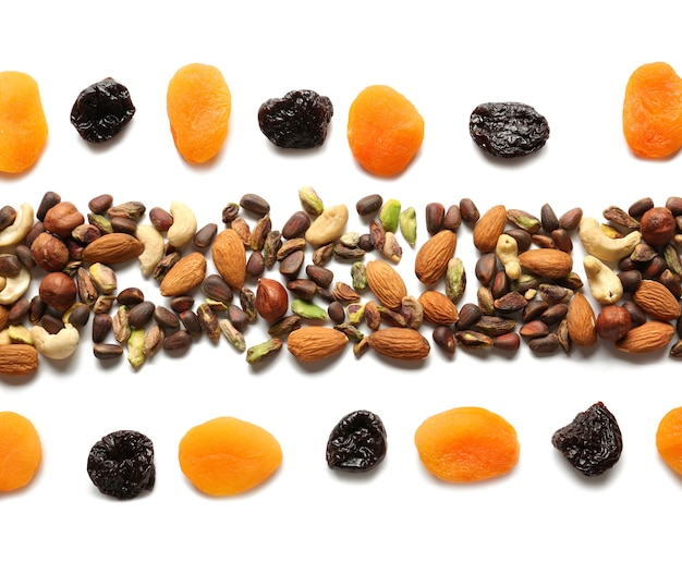 Composition with different nuts and dried fruits on white background