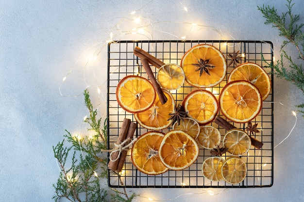 Composition with dried oranges, spices and christmas lights