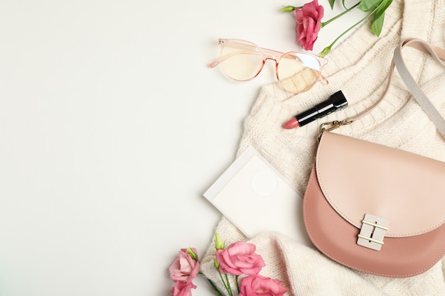 Composition with female accessories on white. woman blogger