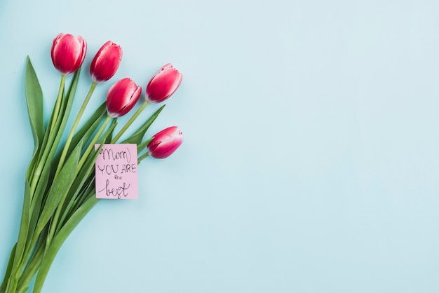 Composition with flowers and cute note for mother's day