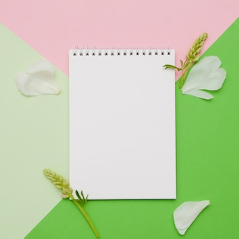 Composition with flowers and notebook with geometric shapes