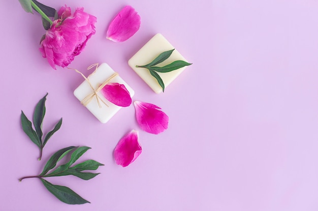 Composition with flowers, petals of peony, natural organic soap. beauty, skin care concept. flat lay, top view