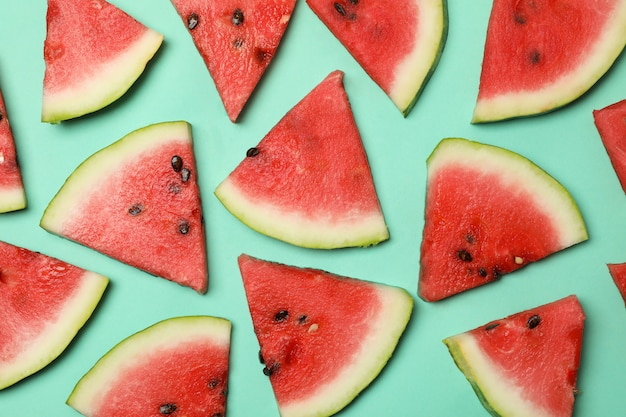 Composition with fresh watermelon slices on mint space, top view