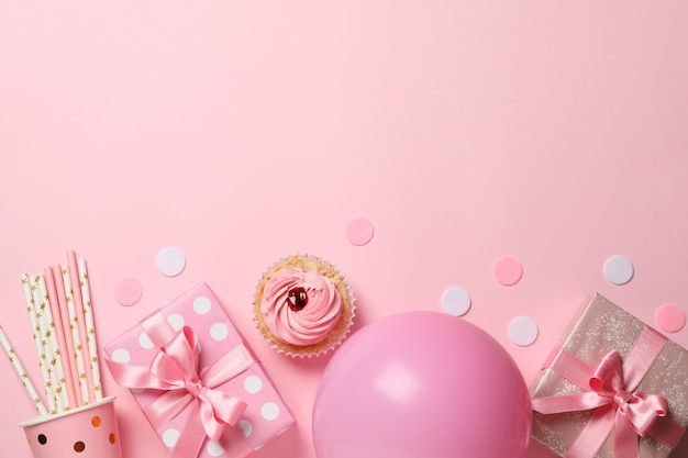 Composition with gift boxes and balloon on pink background, space for text