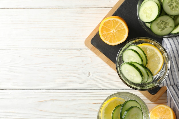 Composition with glasses of cucumber water on wooden surface