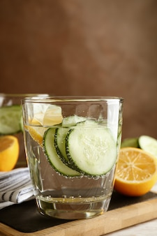 Composition with glasses of cucumber water on wooden table