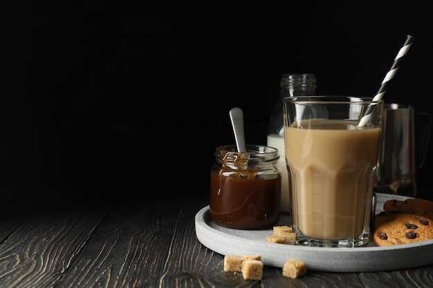 Composition with ice coffee and cookies on wooden space
